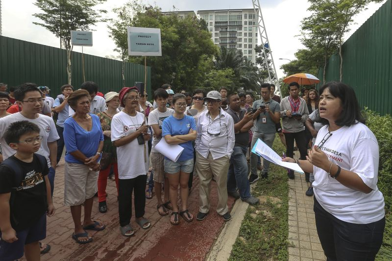 Tiara Faber resident Valerie Low speaks during a protest against a new condominium project at their neighbourhood in Kuala Lumpur. ― Picture by Yusof Mat Isa