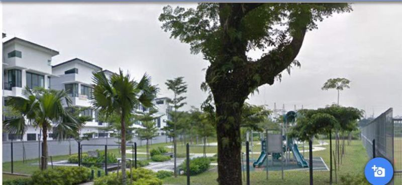 A close-up view of the playground next to Armada Villa units that are all less than four-storey high.