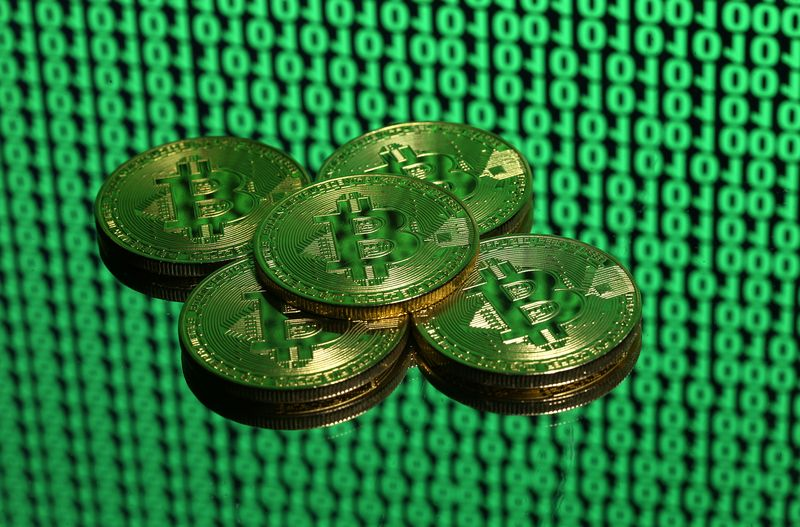 Illustration picture shows tokens of the virtual currency Bitcoin being placed on a monitor that displays binary digits, December 8, 2017. — Reuters pic