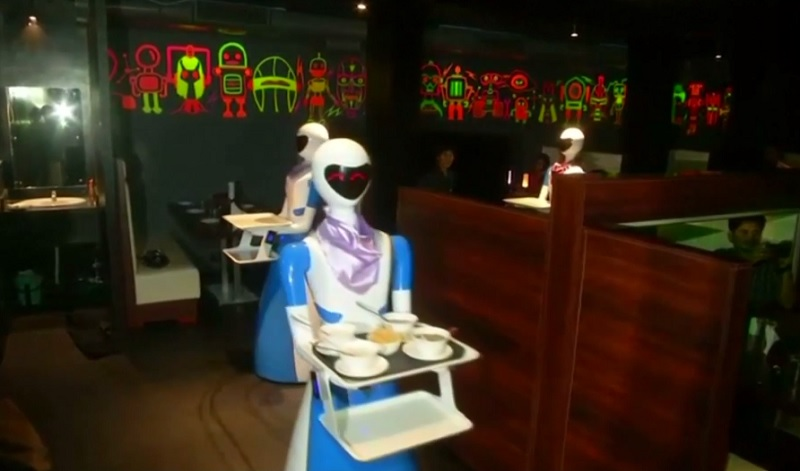 Robot waiters serve customers at the Robot Theme Restaurant in India. — Reuters pic