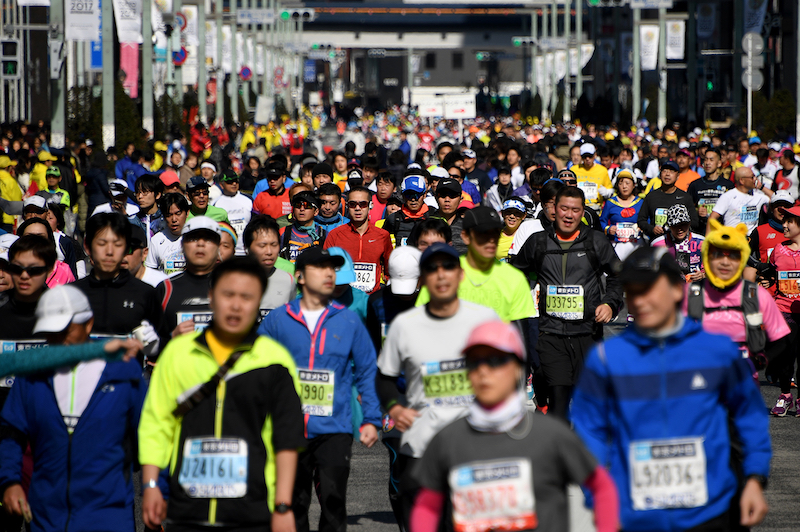 File picture of runners passing the Ginza shopping district during the Tokyo Marathon 2017 in Tokyo. — AFP pic