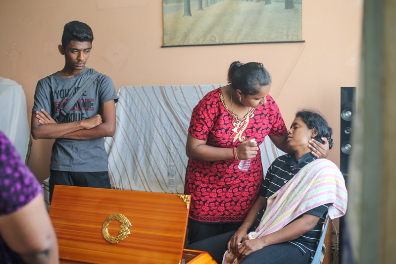 S. Kasthuri Bai (right) is comforted by relatives as she mourns the death of her 15-year-old son Satiswaran.