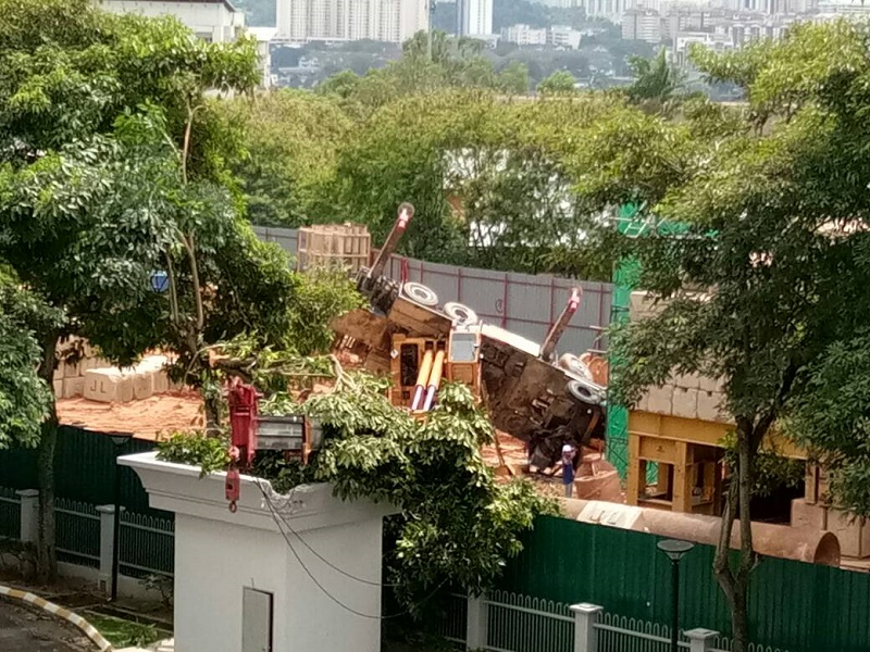 A Taman Desa resident said the crane operating at The Address project site toppled at 2.03pm, with its arm falling onto a concrete structure inside the compound of Tiara Faber. — Picture courtesy of Protect Taman Desa coalition