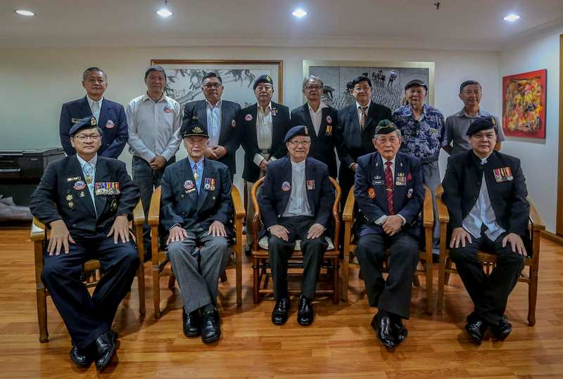 Malaysian Armed Forces Chinese Veterans Association pose for group photo after press conference at The Boulevard Mid Valley City January 15, 2018. — Picture by Firdaus Latif