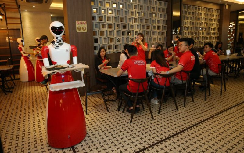 Nam Heong Kopitiam has imported 10 robots to work at its outlets in Malaysia. — Picture by Marcus Pheong