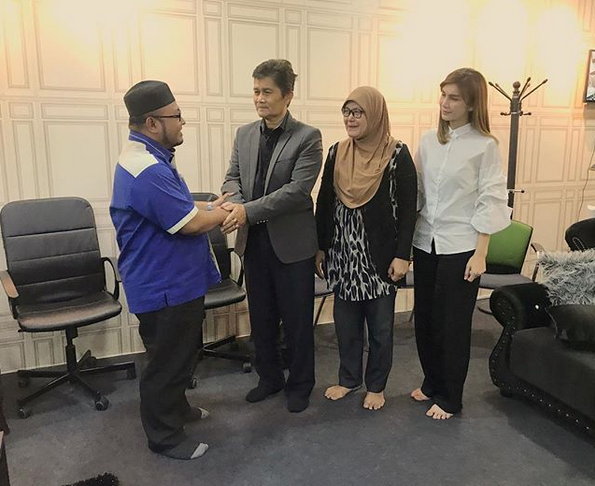 Nur Sajat (far right) posted on her Instagram account a picture of her meeting with an unidentified man wearing a skullcap whom she listed only as a Jakim officer.