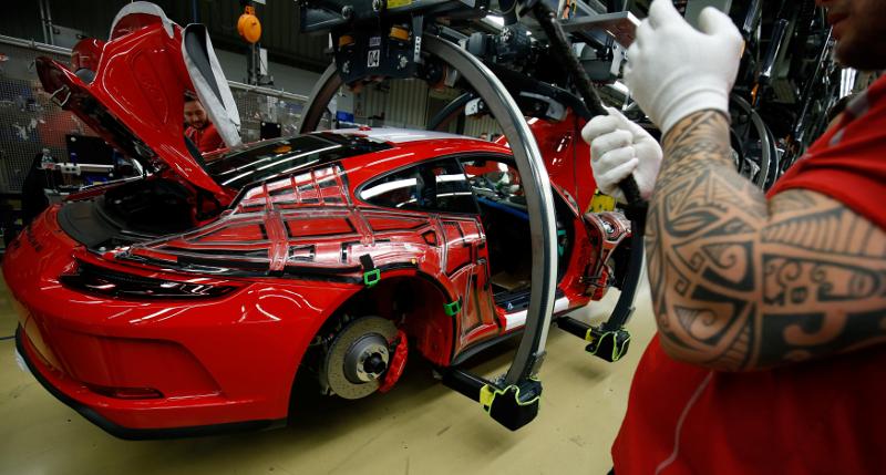 Employees of German car manufacturer Porsche work on a Porsche 911 GT3 RS at the Porsche factory in Stuttgart-Zuffenhausen January 26, 2018. — Reuters pic