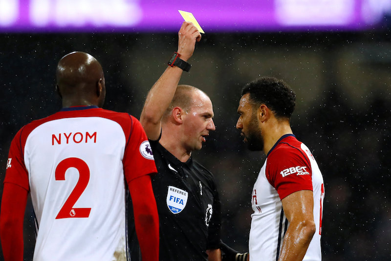 West Bromwich Albion's Matt Phillipsis shown a yellow card by referee Bobby Madley, February 1, 2018.  — Action Images handout via Reuters