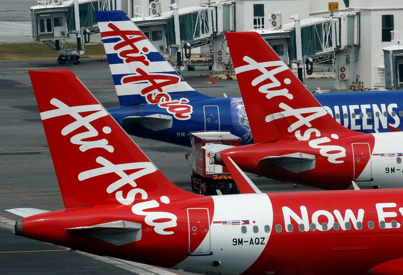 AirAsia planes sit on the tarmac at Kuala Lumpur International Airport August 28, 2016. — Reuters pic