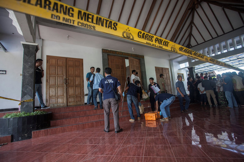 Police are seen outside the Lidwina Catholic Church after a knife-wielding attacker wounded four church-goers in Sleman, Yogyakarta, Indonesia February 11, 2018 in this photo taken by Antara Foto. — Handout via Reuters
