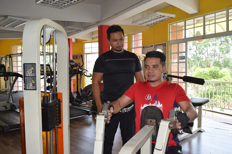 Average Joe Gym manager Mohd Shahir (left) said dedication is of the utmost importance if one wants to see progress after signing up at a gym.