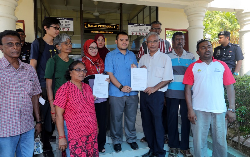 People's Tribunal coordinator Dr Jeyakumar Devaraj (third left) handing the Perak People's Tribunal invitation to Hanita Alang Ismail (sixth left) and Asad Safwan Mazlan (fifth left) in Ipoh February 27, 2018. — Picture by Farhan Najib