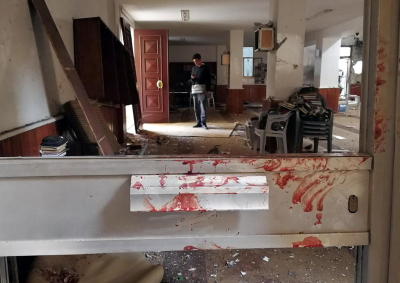 Blood stains a door following a twin bombing inside a mosque in Benghazi, Libya February 9, 2018. — Reuters pic