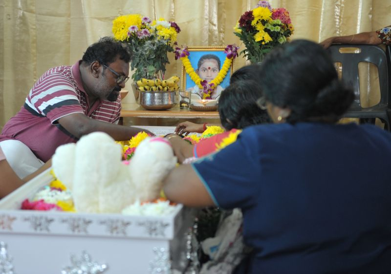 R. Muniandy giving a farewell kiss to his daughter Vasanthapiriya during the wake in their home at Kampung Tong Hai, Nibong Tebal, Penang, February 1, 2018. — Picture by KE Ooi
