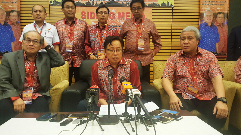 Chief Minister Datuk Patinggi Abang Johari Openg (centre) speaks to reporters, says Petronas must comply with the state law, February 11, 2018. — Picture by Sulok Tawie
