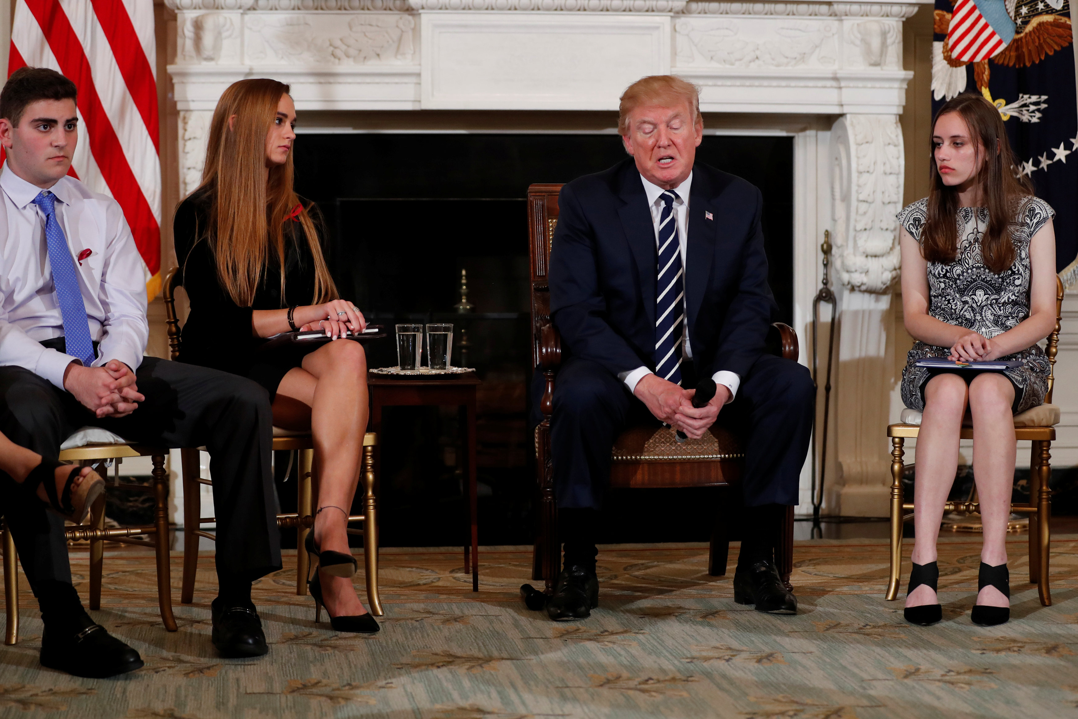 US President Donald Trump, seated with (from left) Jonathan Blank, Julia Cordover and Carson Abt at the White House in Washington, February 21, 2018. — Reuters pic