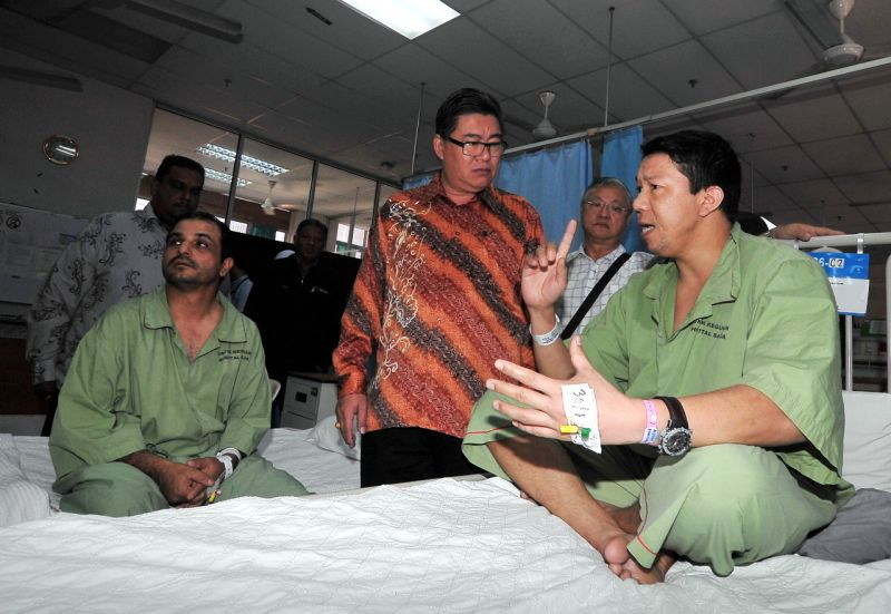 On Jan 31, two Nepalese security guards (in green) were hospitalised after they consumed sachets of the same coffee mixture. Their blood and urine samples were sent for testing on February 2. ― Bernama pic