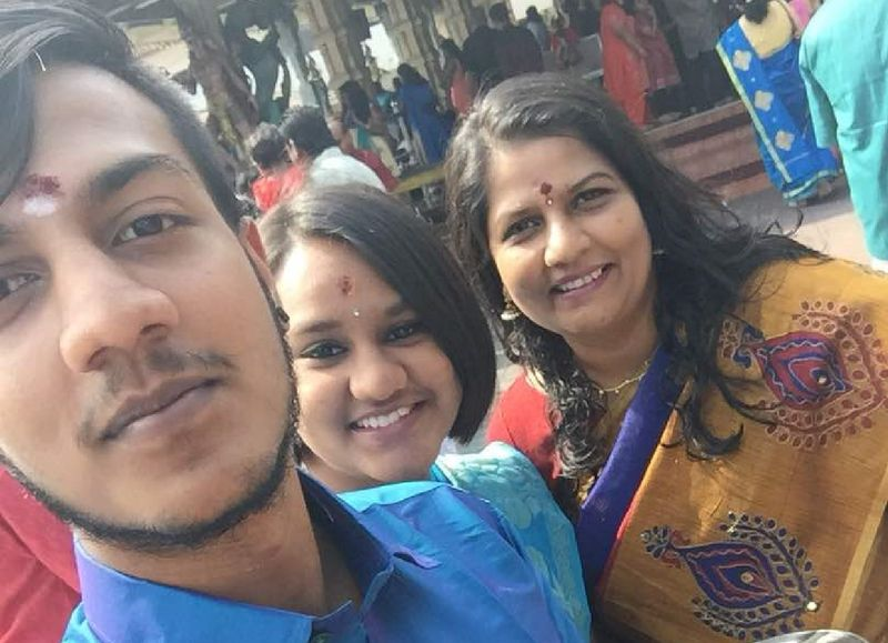 (From left) The two elder children Karan Dinish, Tevi Darsiny and their mother M. Indira Gandhi are seen here in a photo taken during Deepavali 2017. ― Picture courtesy of M. Indira Gandhi