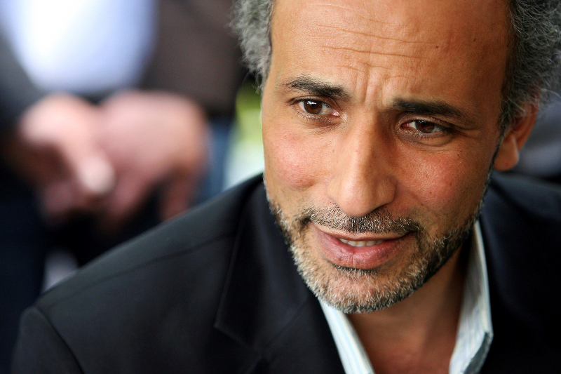 Tariq Ramadan talks with a journalist after a conference at the Er-Rahma mosque in Nantes April 25, 2010. — Reuters pic