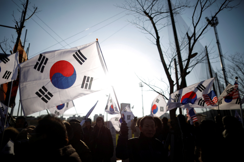 Members of a conservative civic group wave South Korean flags during an anti-North Korea protest in Incheon February 4, 2018. — Reuters pic