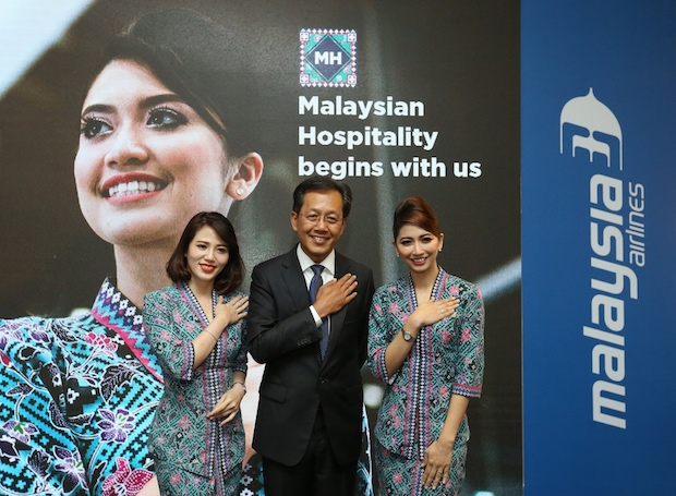 Malaysia Airlines Bhd Group CEO Captain Izham Ismail poses with stewardesses after the launch of the newly refurbished Golden Lounge in KLIA in Sepang March 22, 2018. — Picture by Zuraneeza Zulkifli