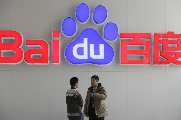 People talk in front of a Baidu's company logo at Baidu's headquarters in Beijing January 16, 2014. — Reuters pic