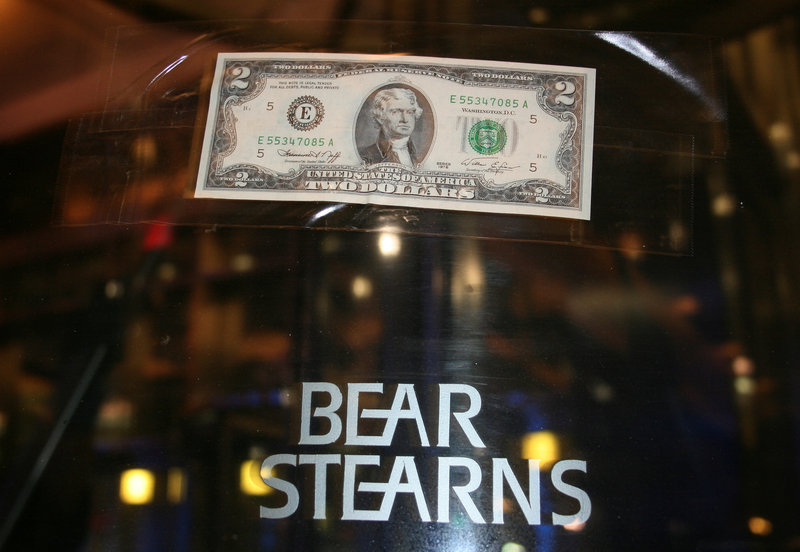 A US two dollar bill is taped to the revolving door leading to the Bear Stearns global headquarters in New York March 17, 2008. — Reuters pic