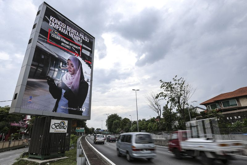 A billboard advertisement discouraging the dissemination of fake news is pictured along Jalan SS20/27, Damansara Jaya March 26, 2018. — Picture by Azneal Ishak