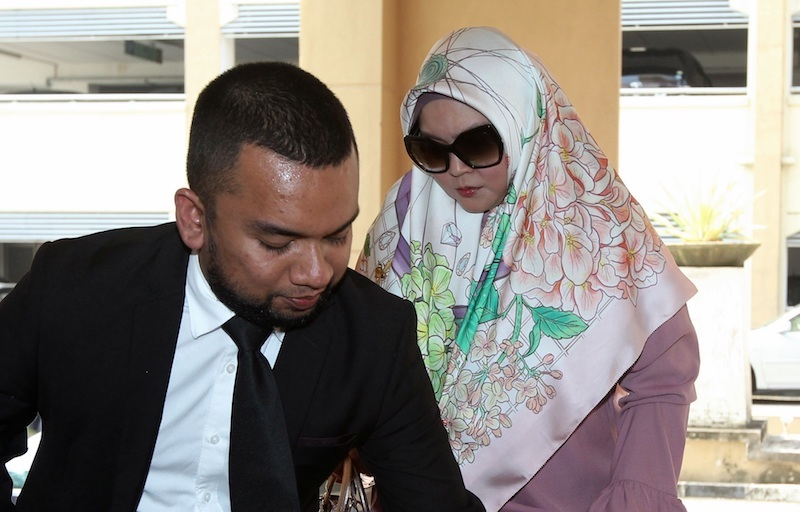 Datin Rozita Mohamad Ali leaves the Sessions Court in Petaling Jaya after being charged with abusing her Indonesian domestic helper in 2016. — Picture by Sin Chew Daily