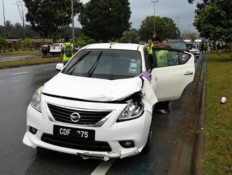 The car said to have been driven by the event volunteer that crashed into four runners on Sunday morning. — Picture courtesy of PDRM