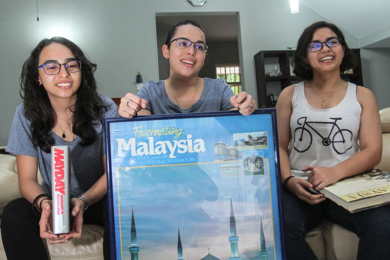 (From left) Tun Mayday, Tun Malaysia and Tun Mardeka share their stories with Malay Mail at their home in Shah Alam. ― Picture by Shafwan Zaidon