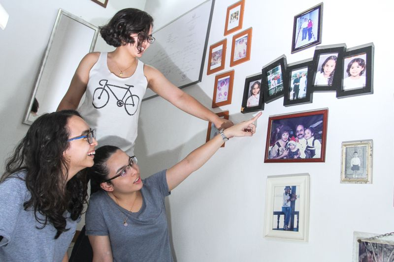 Tun Mardeka, Tun Mayday and Tun Malaysia show Malay Mail pictures from their childhood. ― Picture by Shafwan Zaidon