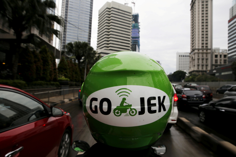 A Gojek driver rides his motorcycle through a business district street in Jakarta June 9, 2015. — Reuters pic