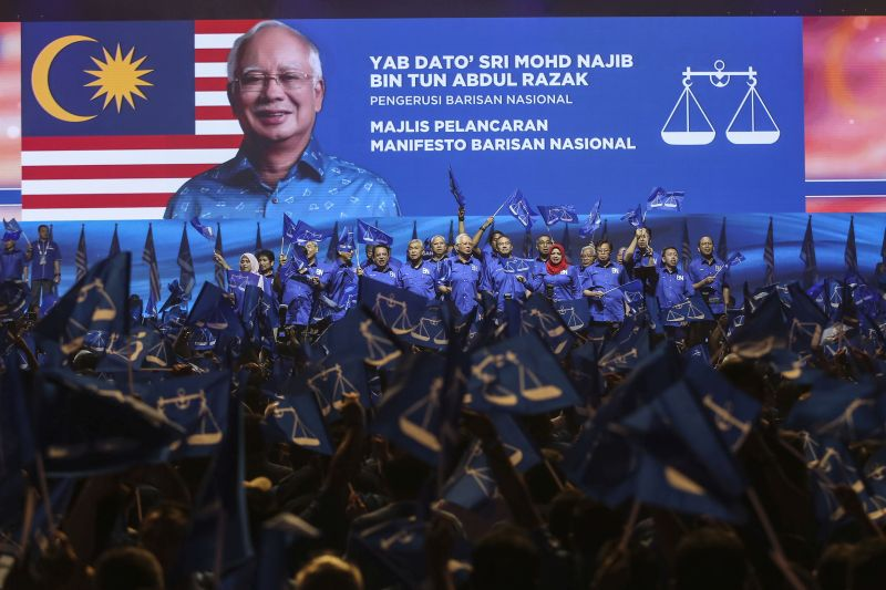 Prime Minister Datuk Seri Najib Tun Razak (centre) and other party members sing Negaraku during the launch of the Barisan Nasional manifesto at Axiata Arena in Bukit Jalil on April 07, 2018. — Picture by Yusof Mohd Isa