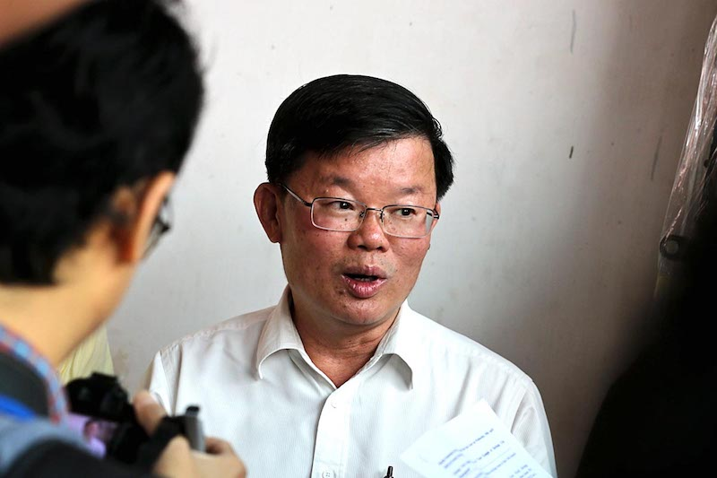 Penang State Executive Councillor Chow Kon Yeow speaks to the press about the pre-war shoplot restoration project at Lebuh Kimberley in George Town April 18, 2018. — Picture by Sayuti Zainudin