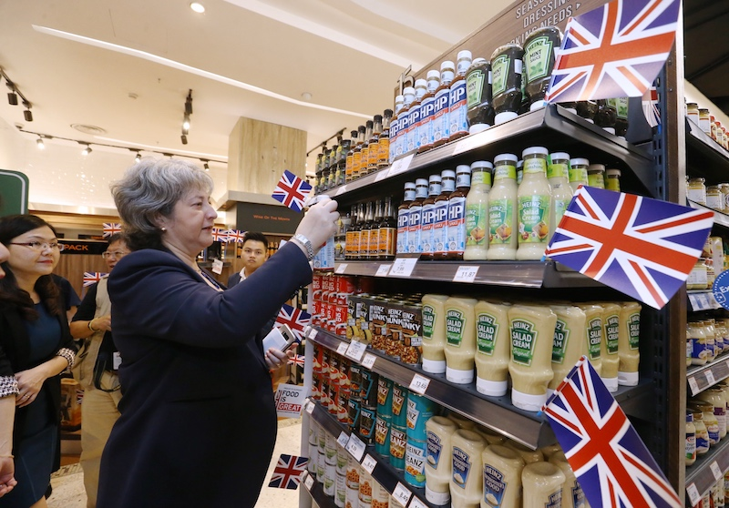 Treadell checks out some of the British goods on offer in Malaysia. — Picture by Zuraneeza Zulkifli