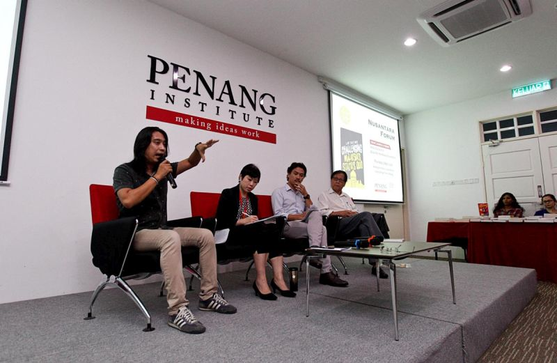 Social activist Adam Adli (left) speaks during a forum titled 'Will the Malay ground shift?' at the Penang Institute, George Town on April 5, 2018. — Picture by Sayuti Zainudin