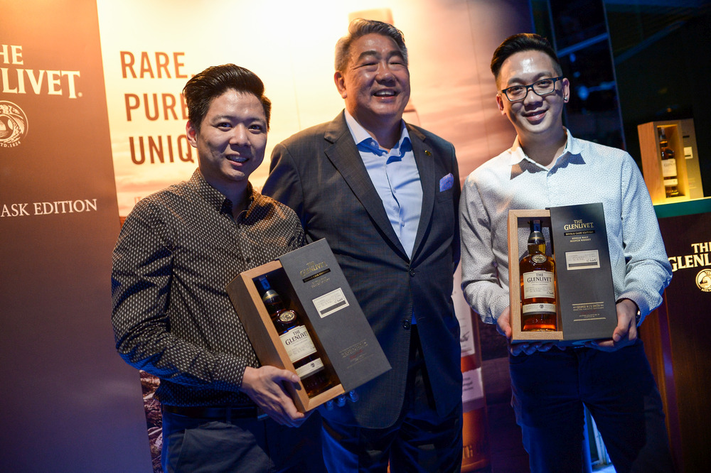 (From Left) Pernod Ricard Malaysia senior brand executive Kent Lim, Lau and Yong unveil The Glenlivet 15-Year-Old Single Cask Edition (Cask 906283) in Kuala Lumpur. — Pictures by Mukhriz Hazim