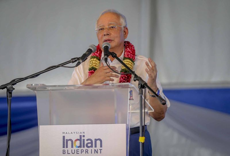Datuk Seri Najib Razak speaks during the the launch of a Special Investment Scheme for the Indian community at the Kerinchi People's Housing Project in Kuala Lumpur April 7, 2018. ― Picture by Firdaus Latif