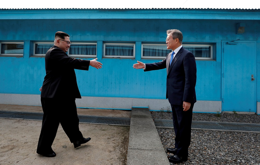 File picture shows South Korean President Moon Jae-in and North Korean leader Kim Jong-un (left) about to shake hands on their first ever meeting at the truce village of Panmunjom in South Korea April 27, 2018. — Reuters pic