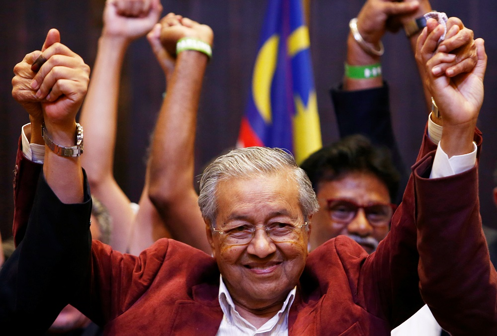Tun Dr Mahathir Mohamad reacts during a news conference in Petaling Jaya May 10, 2018.  — Reuters pic