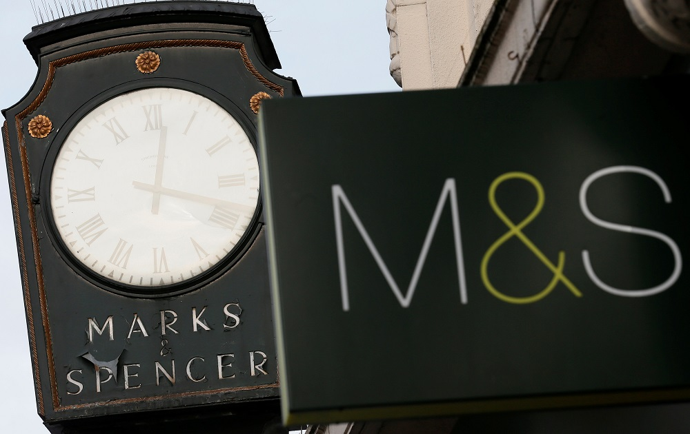 Marks & Spencer signs are seen outside outside a store in London January 8, 2014. — Reuters pic