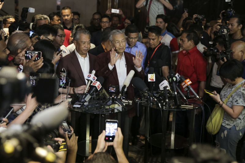 Tan Sri Muhyiddin Yassin and Tun Dr Mahathir Mohamad attend a press conference in Petaling Jaya May 9, 2018. — Picture by Yusof Mat Isa
