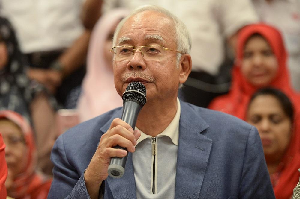 Datuk Seri Najib Razak speaks during a press conference announcing his resignation as Umno president and BN chairman in Kuala Lumpur May 12, 2018. — Picture by Mukhriz Hazim
