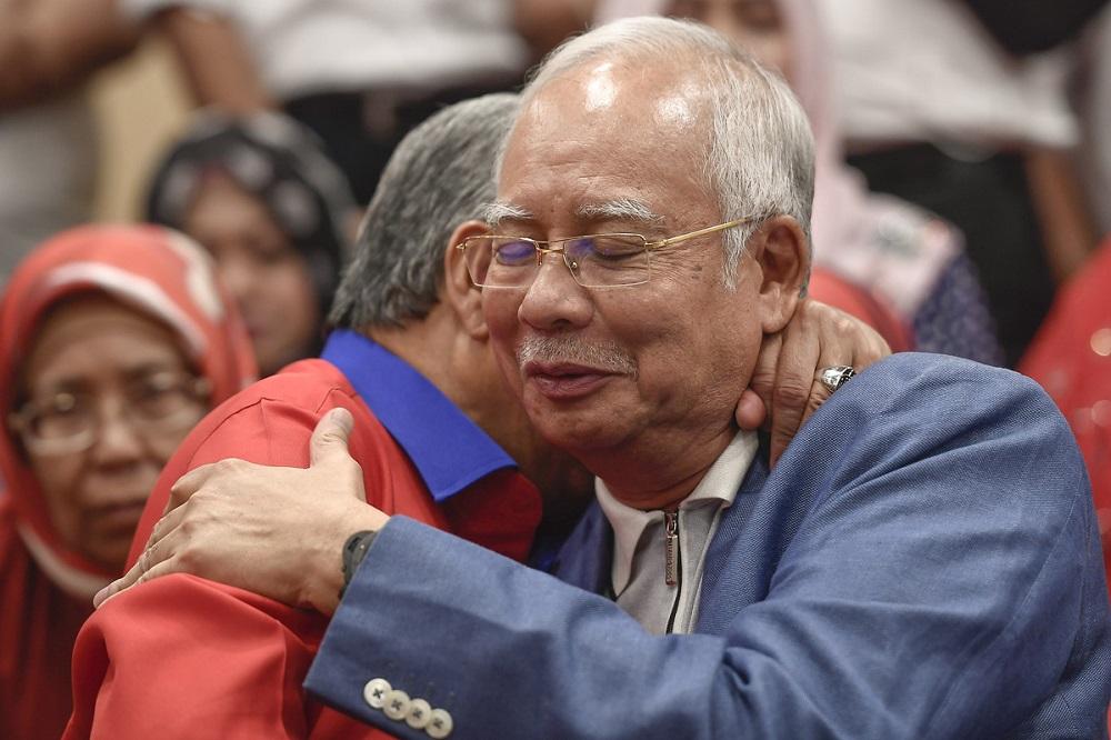 Datuk Seri Zahid Hamidi hugs Datuk Seri Najib Razak during a press conference in Kuala Lumpur May 12, 2018. — Picture by Mukhriz Hazim