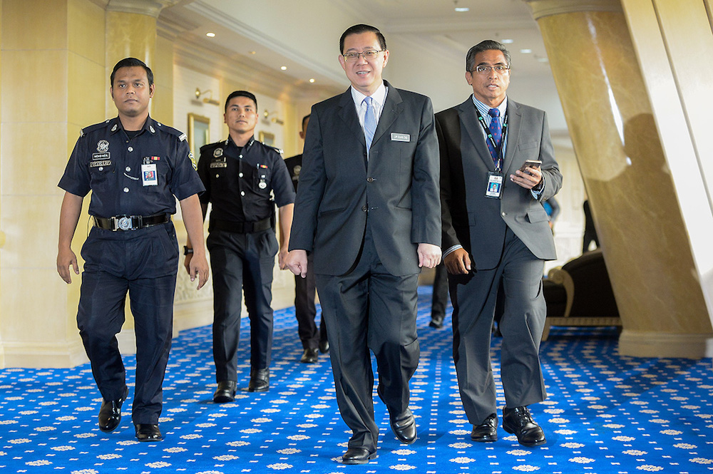 Finance Minister Lim Guan Eng arrives for a press conference at the Ministry of Finance in Putrajaya May 24, 2018. — Picture by Mukhriz Hazim
