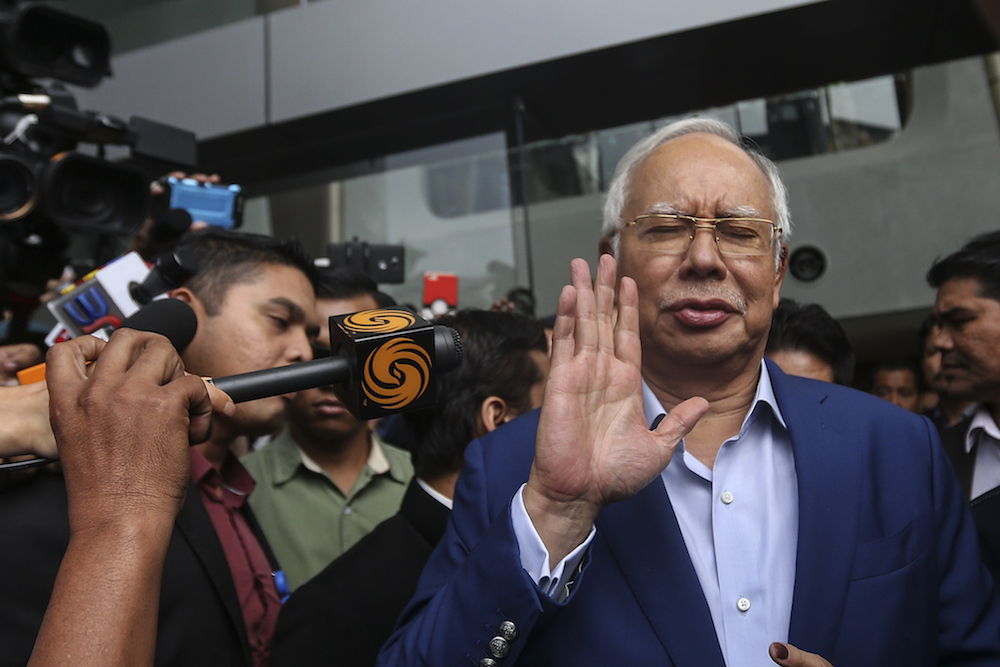 Former Prime Minister Datuk Seri Najib Razak reacts to questions by the media while leaving the MACC headquarters in Putrajaya May 22, 2018. — Picture by Azneal Ishak
