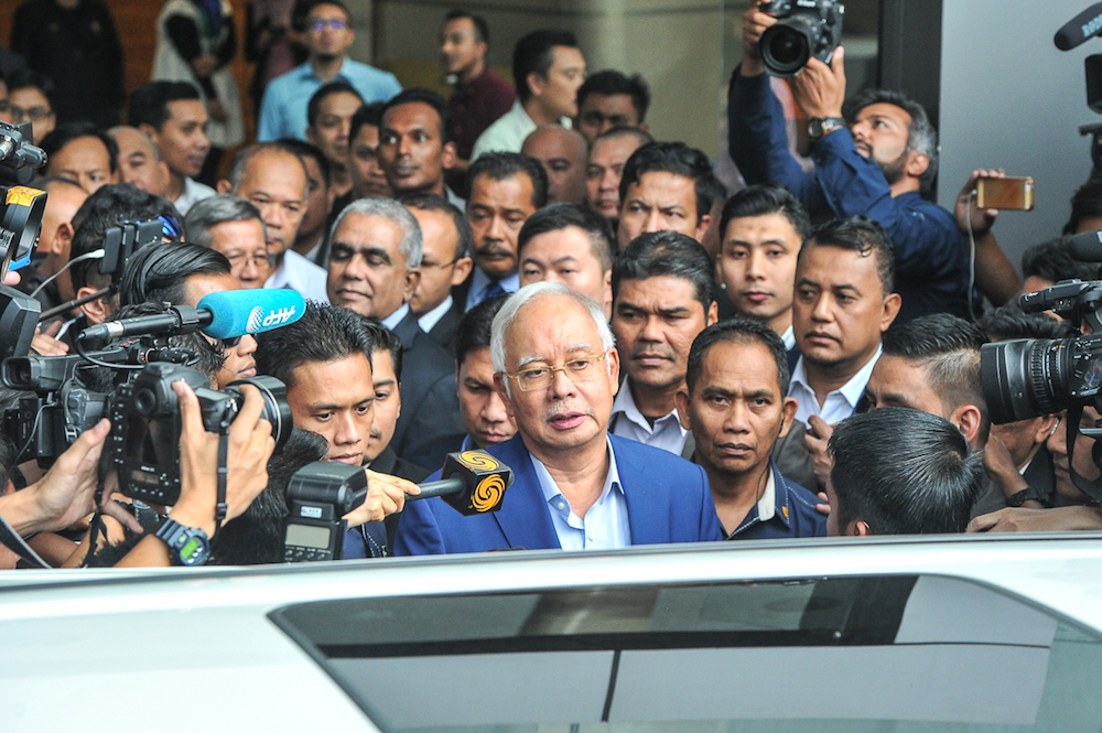 Former Prime Minister Datuk Seri Najib Razak leaves the MACC headquarters in Putrajaya May 22, 2018. — Picture by Shafwan Zaidon
