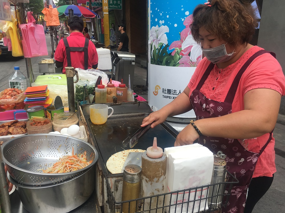 A street vendor in Taipei, Taiwan where urbanisation, rising incomes and concerns about health are driving a move towards more protein-rich alternatives to the staple food, rice April 11, 2018. — Thomson Reuters Foundation pic