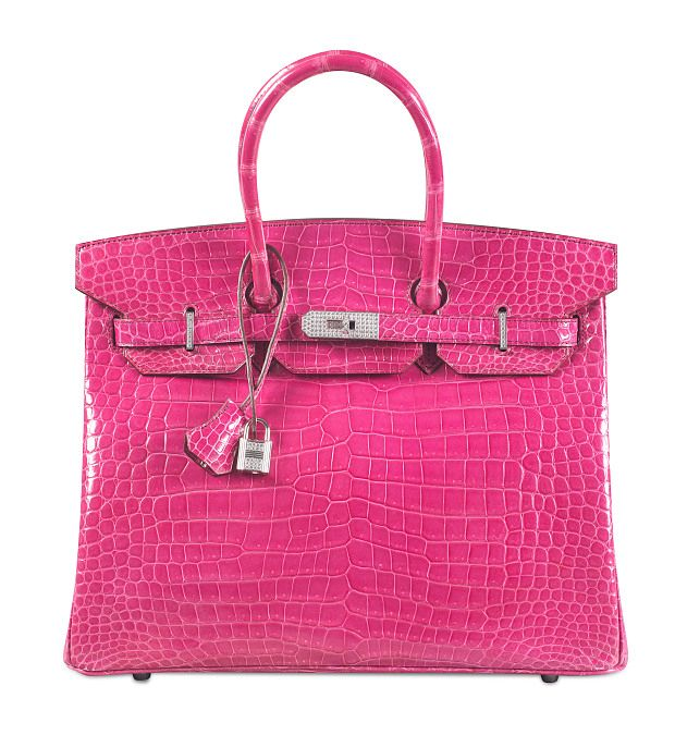 The fuchsia porosus crocodile Hermes Birkin was the most expensive handbag ever sold at its time of auction in 2015. — Picture via Christie's